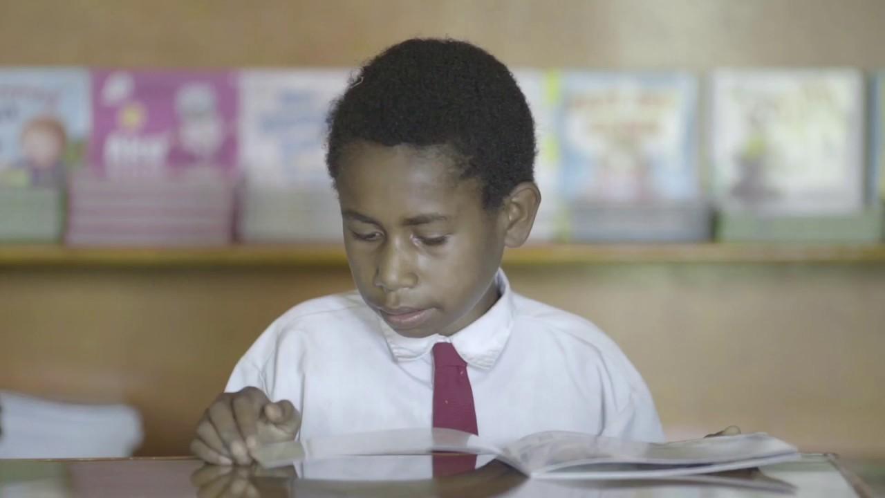 Anak Papua membaca. Foto; UNICEF