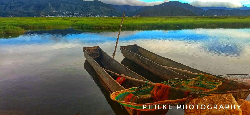 Perahu di Tepi Danau TIigi -Philemon Keiya Doc.